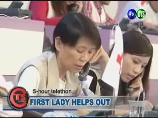 FIRST LADY HELPS OUT
