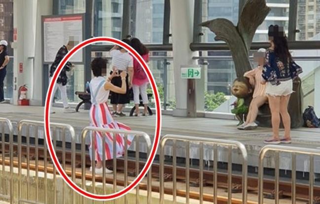 愛美不要命!婦人闖淡海輕軌鐵道拍照 | 華視新聞
